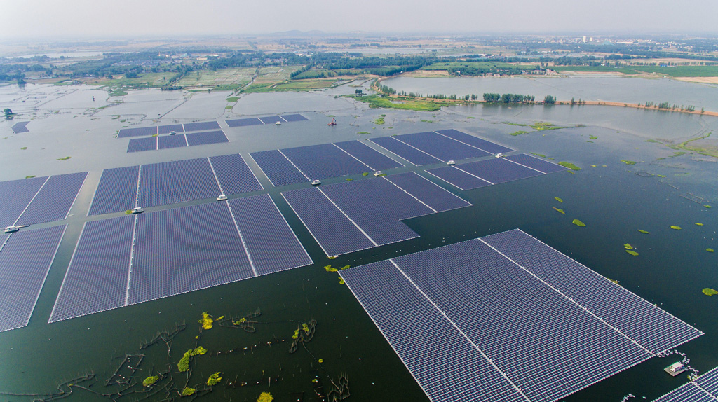 Aerial-view-of-the-world's-largest-floating-solar-energy-plant-with-a-capacity-of-40-megawatts-of-energy-in-Huainan-city,-east-China's-Anhui-province